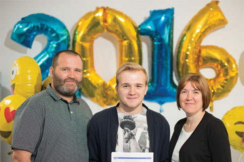 Conor Butler with his parents.