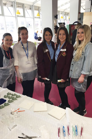 St Helens College Dental Nursing Assessor, Julie McKenzie, with Dental Nursing students and two year 11 Byrchall High students.