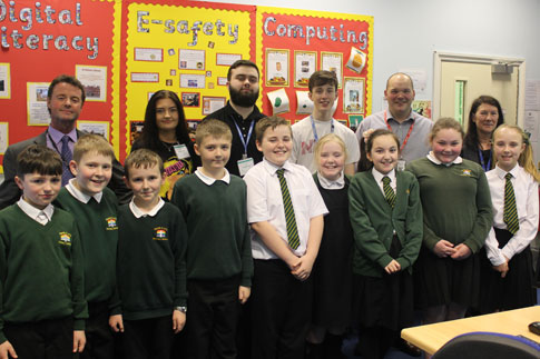 Picture of our students and the staff and pupils at Parish CE Primary School