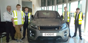 Picture of students with Land Rover